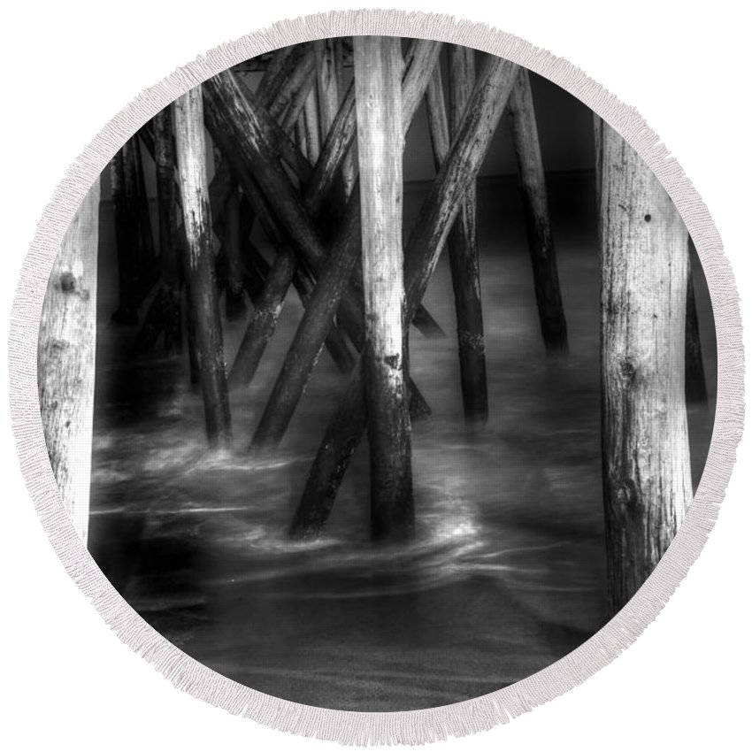 Black And White Photo Round Beach Towel featuring the photograph Under The Pier by Paul Ward