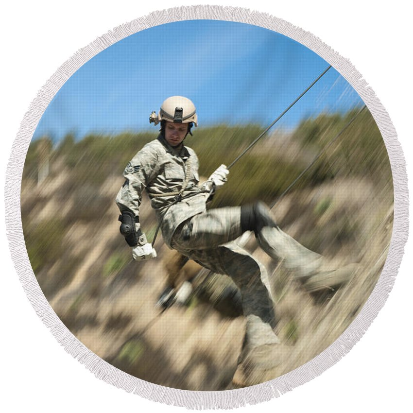 Military Round Beach Towel featuring the photograph U.s. Air Force Airman Practices by Stocktrek Images