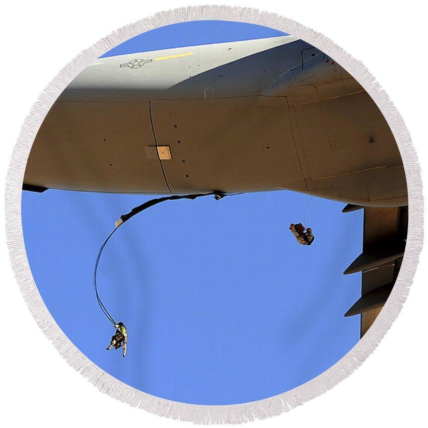 C-17 Round Beach Towel featuring the photograph U.s Air Force Airmen Parachute by Stocktrek Images