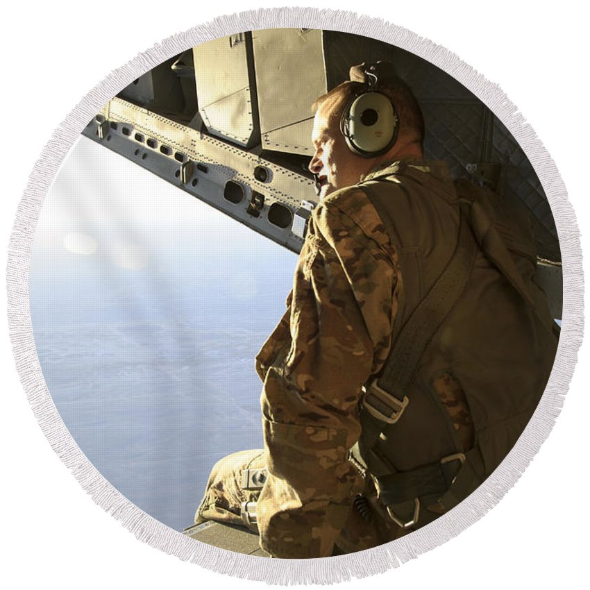 Afghanistan Round Beach Towel featuring the photograph U.s. Air Force Commander Sits Harnessed by Stocktrek Images