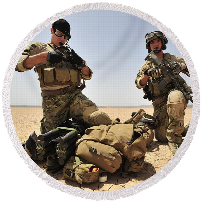 Djibouti Round Beach Towel featuring the photograph U.s. Air Force Soldiers Gather by Stocktrek Images
