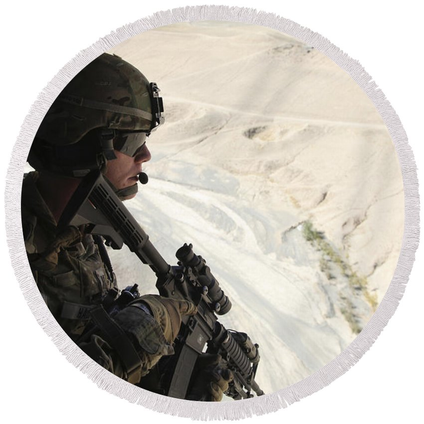 Afghanistan Round Beach Towel featuring the photograph U.s. Army Captain Looks Out The Door by Stocktrek Images