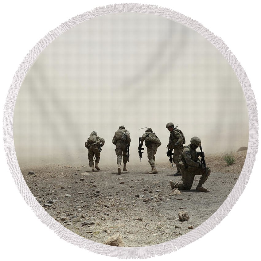 Dust Round Beach Towel featuring the photograph U.s. Army Captain Provides Security by Stocktrek Images