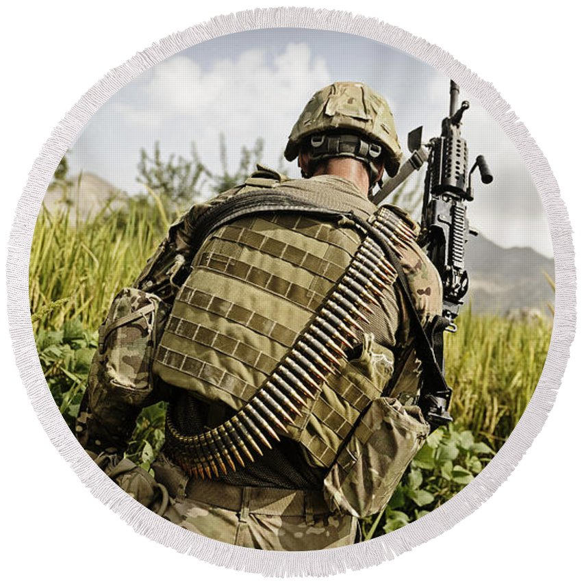Operation Enduring Freedom Round Beach Towel featuring the photograph U.s. Army Mk48 Machine Gunner Patrols by Stocktrek Images