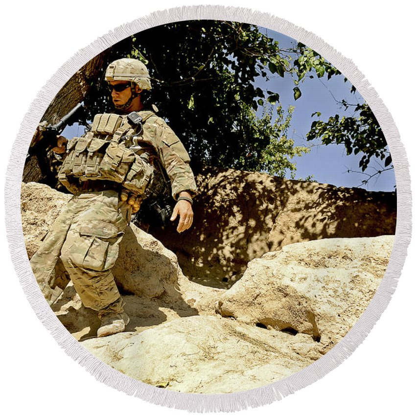 Provincial Reconstruction Team Round Beach Towel featuring the photograph U.s. Army Soldier Climbs Down A Hill by Stocktrek Images