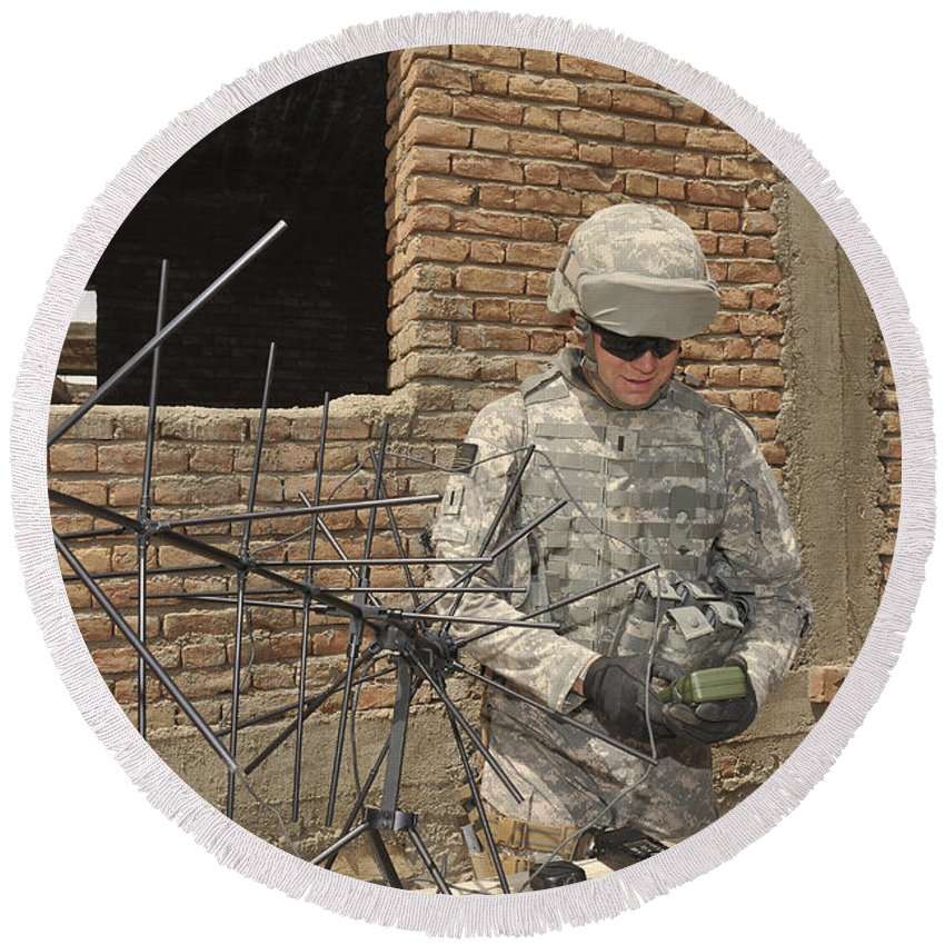 Ghazni Round Beach Towel featuring the photograph U.s. Army Soldier Configures by Stocktrek Images