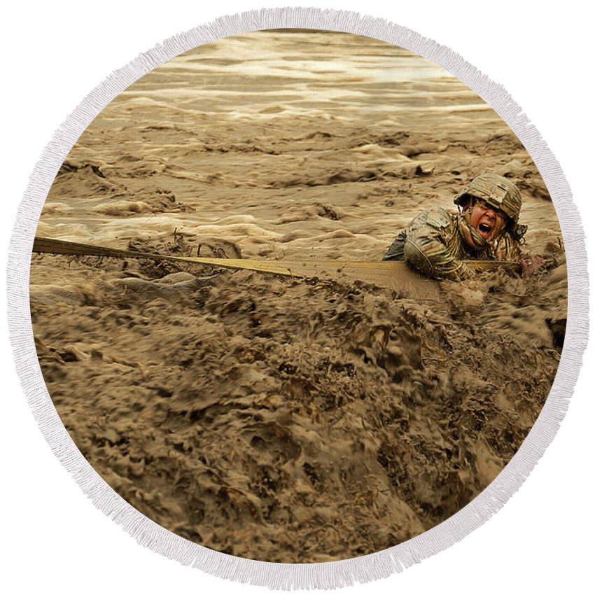 Army Round Beach Towel featuring the photograph U.s. Army Soldier Fights Racing Water by Stocktrek Images