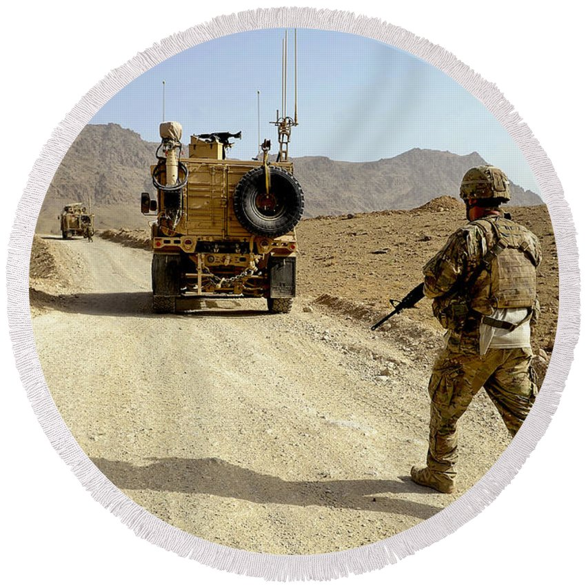 Provincial Reconstruction Team Round Beach Towel featuring the photograph U.s. Army Soldier Moves To His Mrap by Stocktrek Images