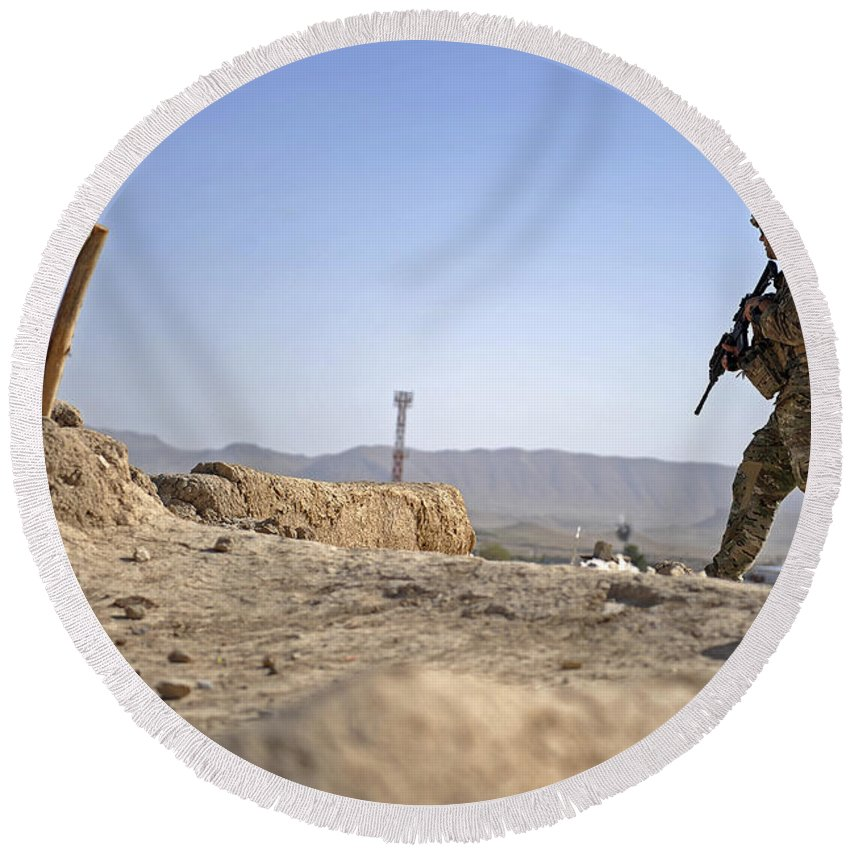 Provincial Reconstruction Team Round Beach Towel featuring the photograph U.s. Army Soldier On A Foot Patrol by Stocktrek Images