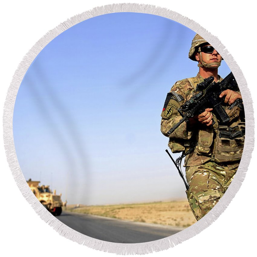 Provincial Reconstruction Team Round Beach Towel featuring the photograph U.s. Army Soldier On Patrol by Stocktrek Images