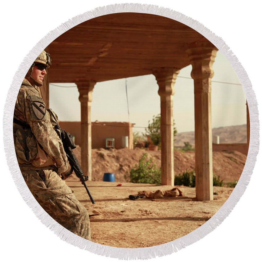 Iraq Round Beach Towel featuring the photograph U.s. Army Soldier Pulls Security by Stocktrek Images