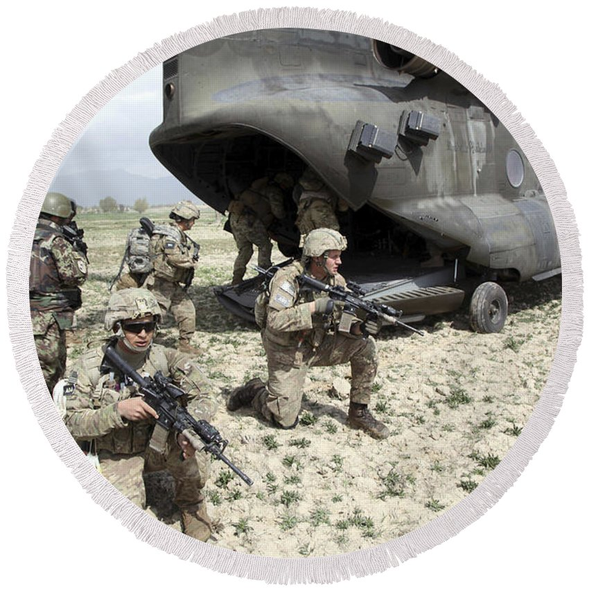 Afghanistan Round Beach Towel featuring the photograph U.s. Army Soldiers Board A Ch-47 by Stocktrek Images