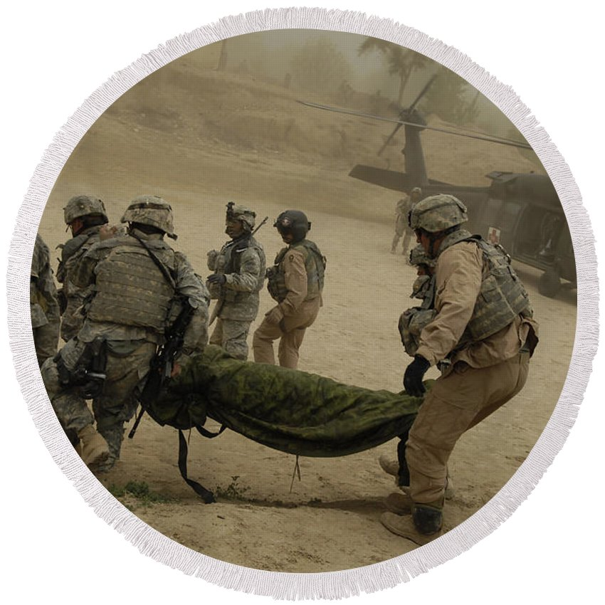 Medium Group Of People Round Beach Towel featuring the photograph U.s. Army Soldiers Medically Evacuate by Stocktrek Images