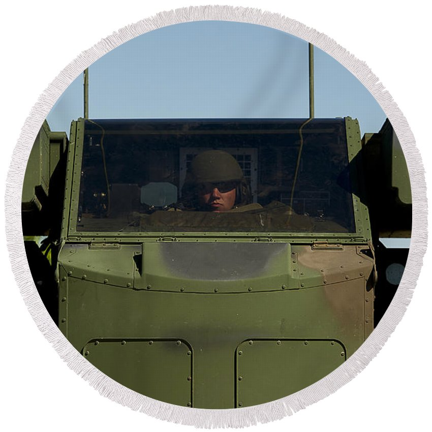Men Round Beach Towel featuring the photograph U.s. Army Specialist Operates An by Stocktrek Images