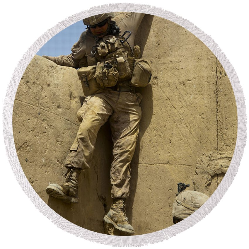 Afghanistan Round Beach Towel featuring the photograph U.s. Marine Climbs Down From An by Stocktrek Images