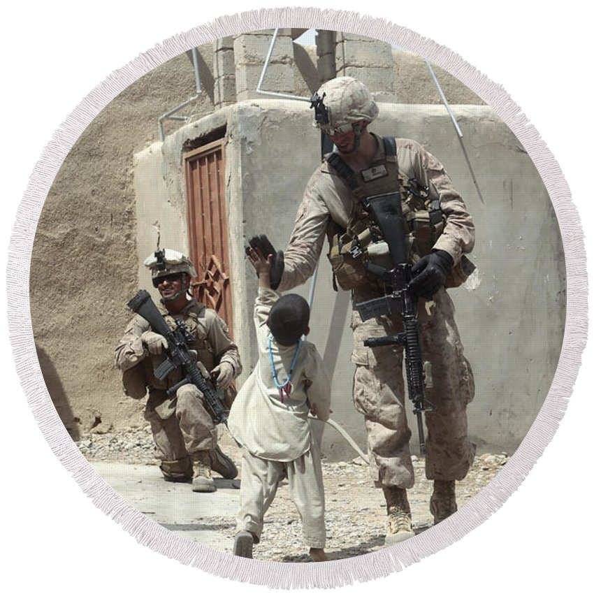 Afghanistan Round Beach Towel featuring the photograph U.s. Marine Gives An Afghan Child by Stocktrek Images