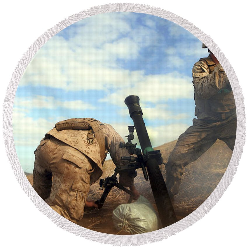 Australia Round Beach Towel featuring the photograph U.s. Marine Holds A Mortar Tube Steady by Stocktrek Images
