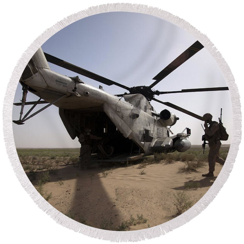 Operation Enduring Freedom Round Beach Towel featuring the photograph U.s. Marines Board A Ch-53d Sea by Stocktrek Images