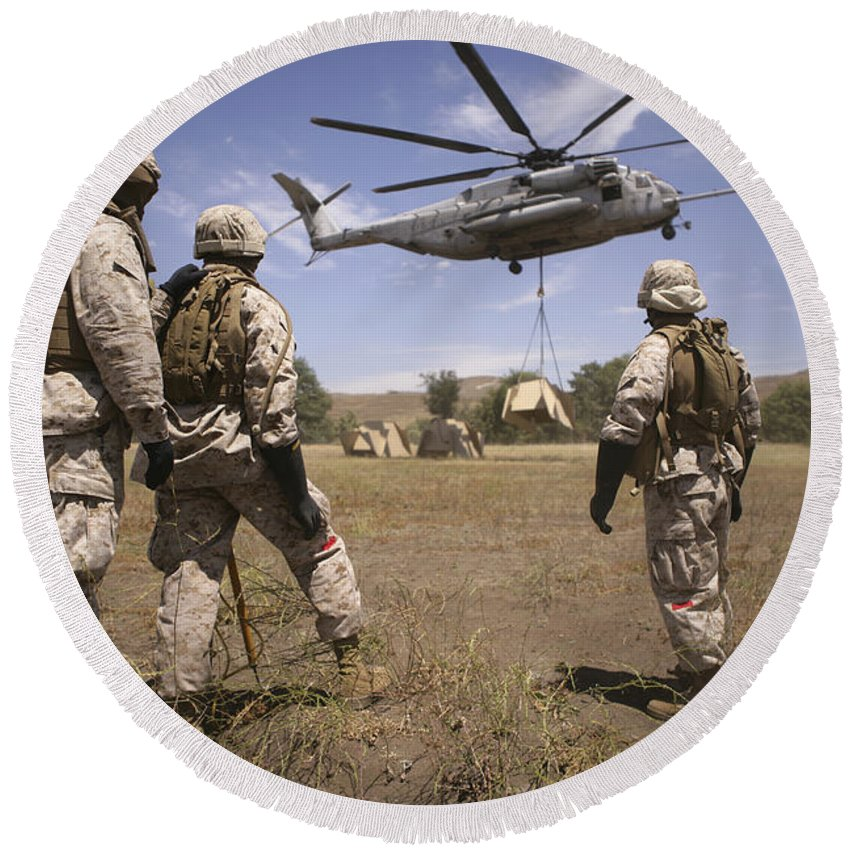 Extraction Round Beach Towel featuring the photograph U.s. Marines Observe Ch-53e Super by Stocktrek Images