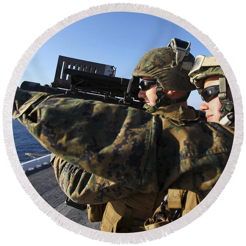 Motioning Round Beach Towel featuring the photograph U.s. Marines Practice Firing by Stocktrek Images