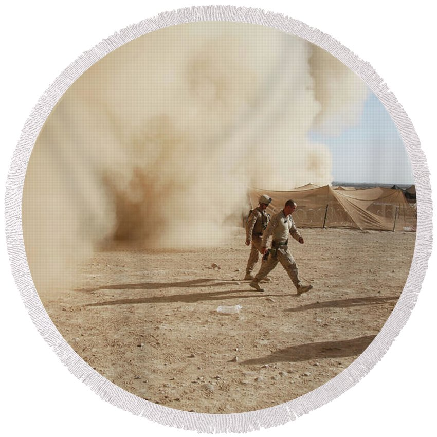 Debris Round Beach Towel featuring the photograph U.s. Marines Walk Away From A Dust by Stocktrek Images