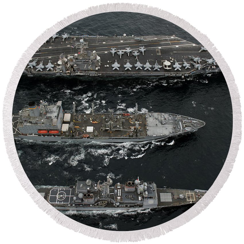 Us Navy Round Beach Towel featuring the photograph U.s. Navy Ships Conduct A Replenishment by Stocktrek Images