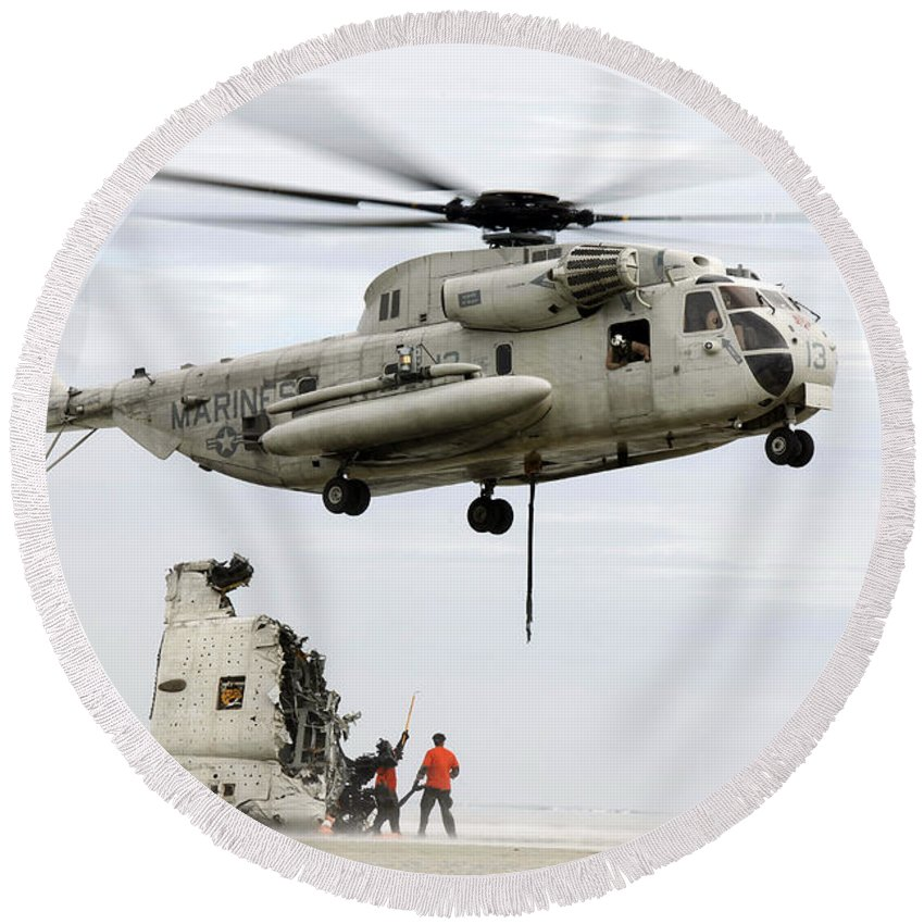 Emergency Round Beach Towel featuring the photograph U.s. Sailors Assist A Ch-53d Sea by Stocktrek Images