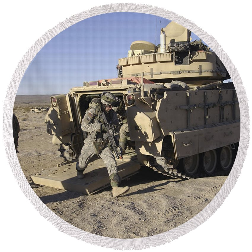 Army Round Beach Towel featuring the photograph U.s. Soldiers Exit From An M2 Bradley by Stocktrek Images
