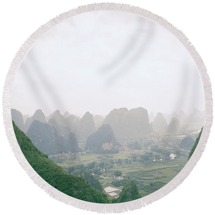 China Round Beach Towel featuring the photograph View Of The Guilin Mountains In Guangxi In China by Shaun Higson