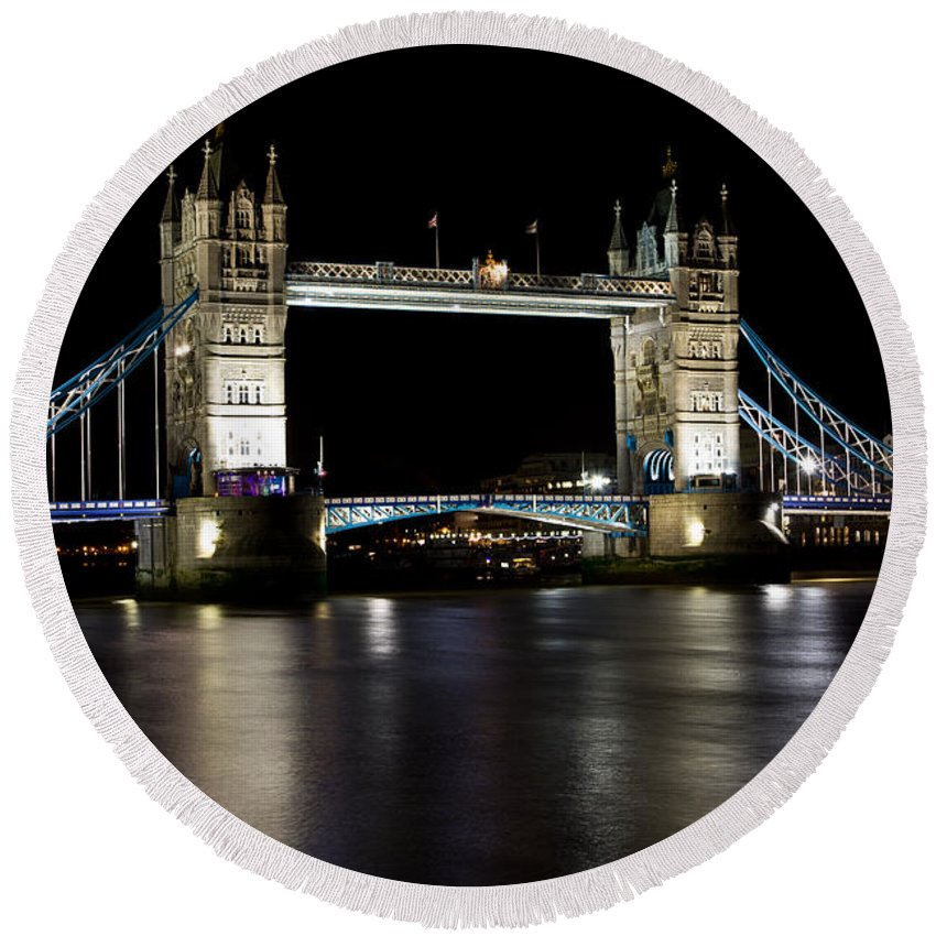 Thames Round Beach Towel featuring the photograph View Of The River Thames And Tower Bridge At Night by David Pyatt