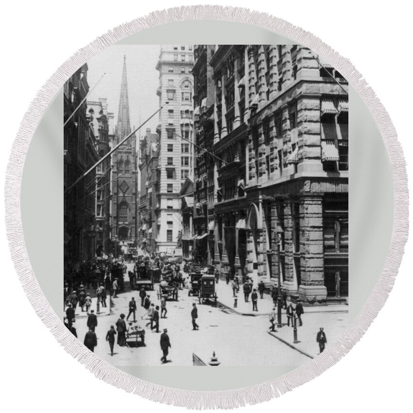 new York City Round Beach Towel featuring the photograph Wall Street Looking Toward Old Trinity Church - New York City - C 1910 by International Images