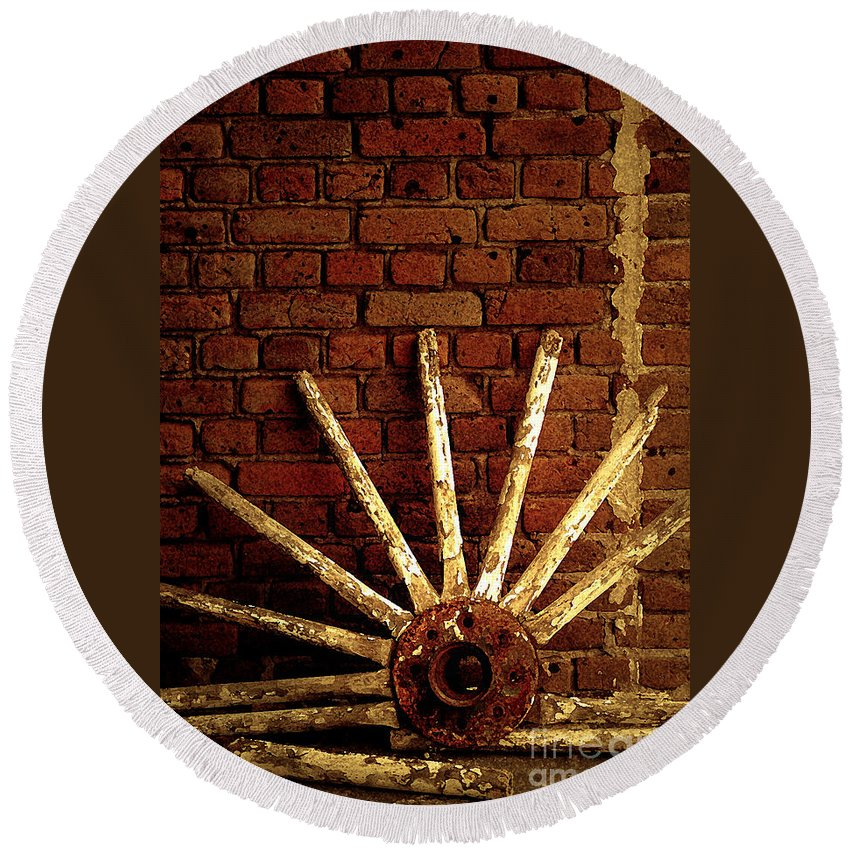 Wheel Round Beach Towel featuring the photograph Wheel Against Wall by Mike Nellums