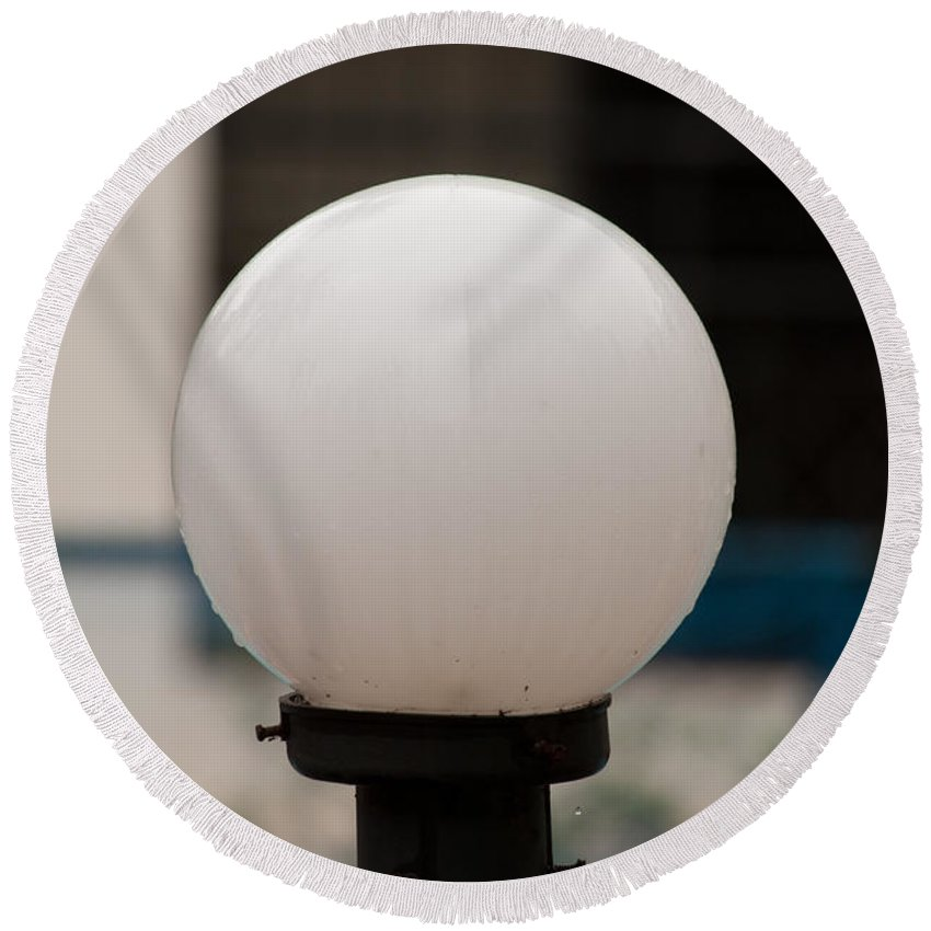 Lamp Round Beach Towel featuring the photograph White Lamp With Some Rain Drops Still Clinging On It by Ashish Agarwal