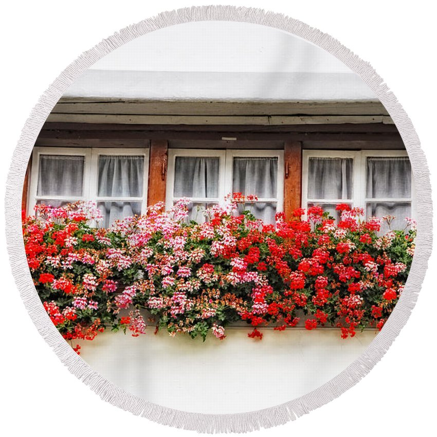 Window Round Beach Towel featuring the photograph Windows With Red Flowers by Mats Silvan