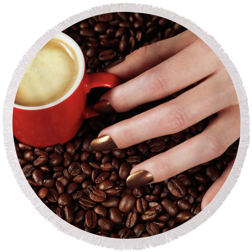 Coffee Round Beach Towel featuring the photograph Woman Hand Holding A Cup Of Latte by Oleksiy Maksymenko
