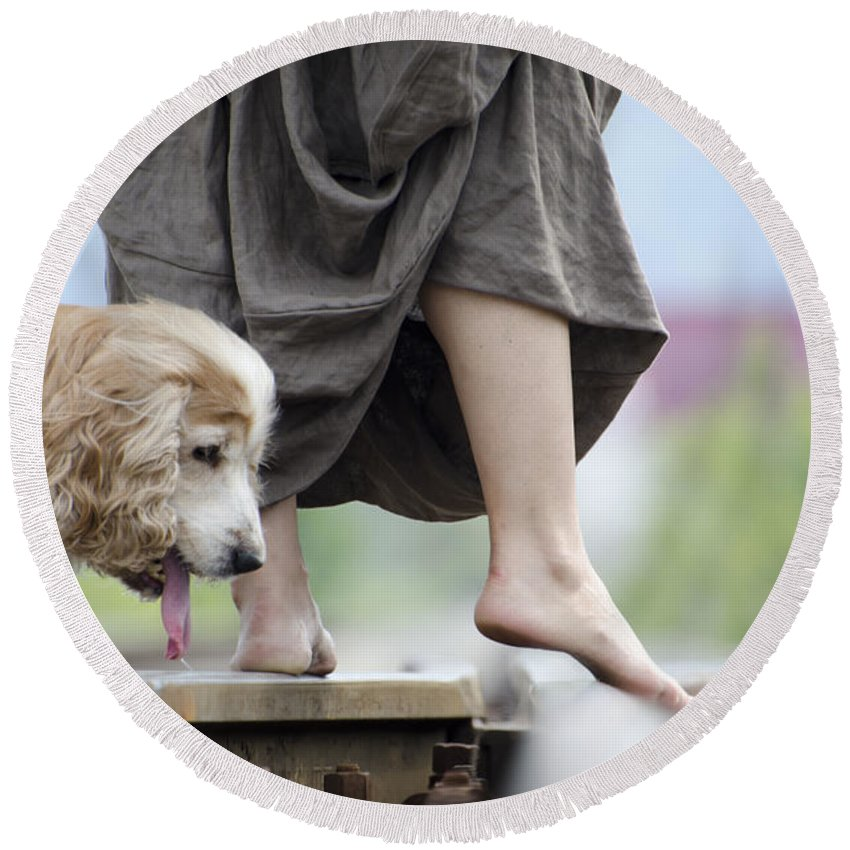 Shoes Round Beach Towel featuring the photograph Woman With A Skirt And A Dog by Mats Silvan