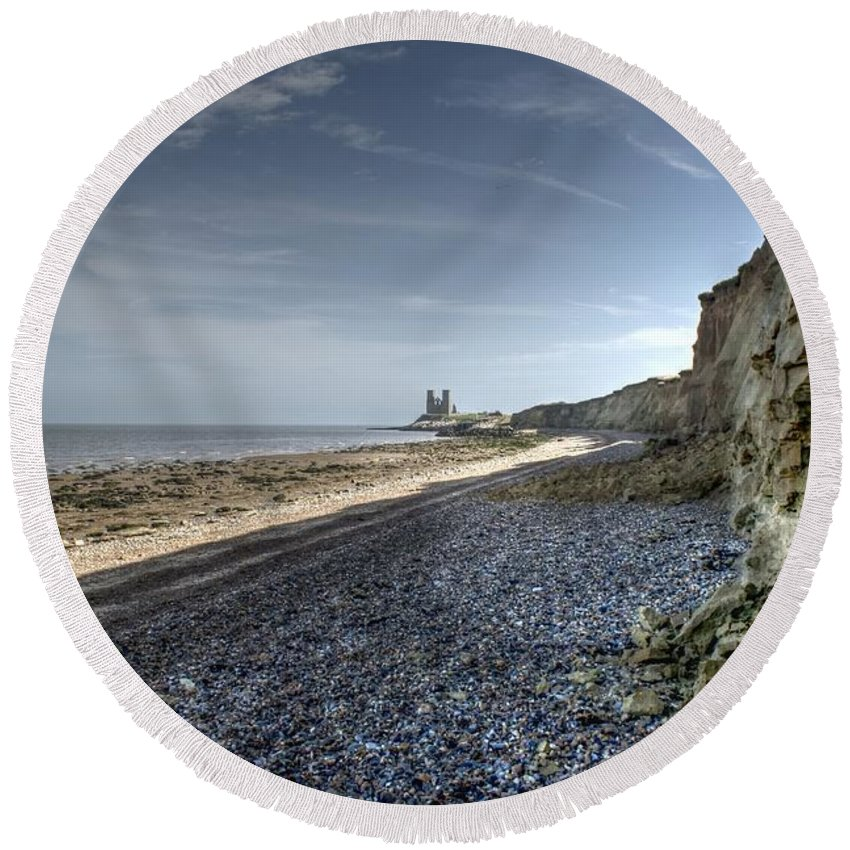 Reculver From Bishopstone Beach Round Beach Towel featuring the photograph Reculver From Bishopstone Beach by Dave Godden