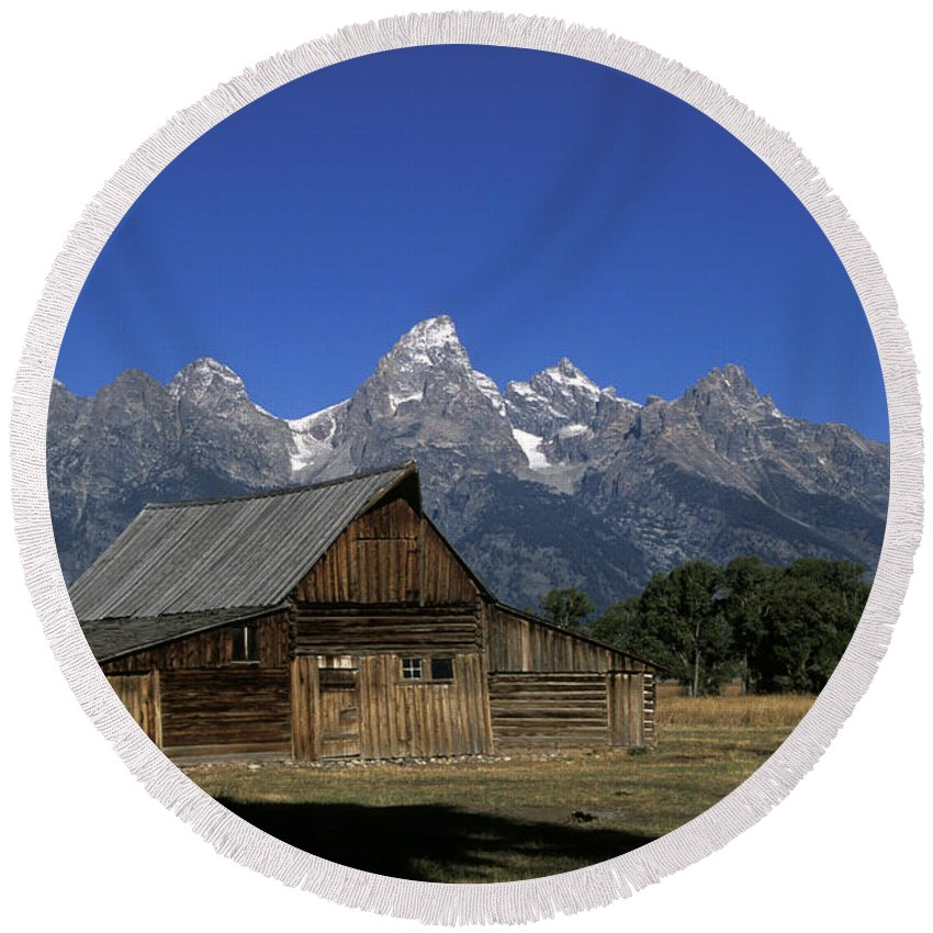 Late Snow Round Beach Towel featuring the photograph South Moulton Barn Grand Tetons by Gary Langley