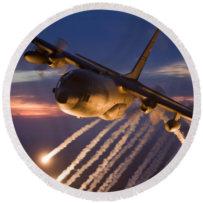 Smoke Round Beach Towel featuring the photograph A C-130 Hercules Releases Flares by HIGH-G Productions