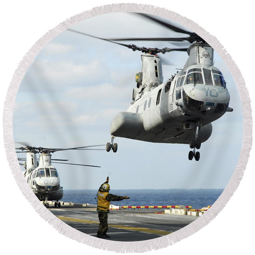 Humanitarian Assistance Round Beach Towel featuring the photograph A Ch-46e Sea Knight Helicopter Takes by Stocktrek Images