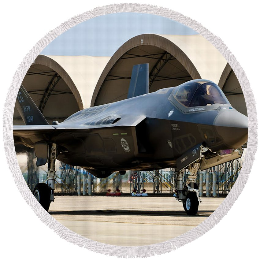 Aerospace Round Beach Towel featuring the photograph An F-35 Lightning II Taxiing At Eglin by Stocktrek Images