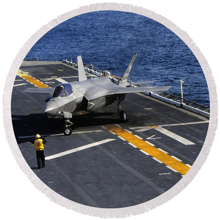 Stealth Round Beach Towel featuring the photograph An F-35b Lightning II Makes A Vertical by Stocktrek Images