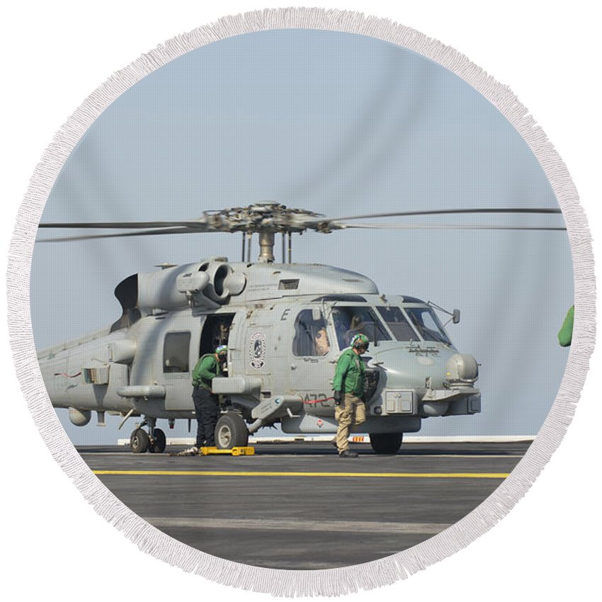 Horizontal Round Beach Towel featuring the photograph An Mh-60r Seahawk Embarked Aboard Uss by Giovanni Colla