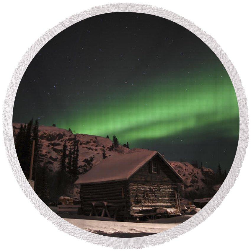 Yellowknife Round Beach Towel featuring the photograph Aurora Borealis Over A Cabin, Northwest by Jiri Hermann