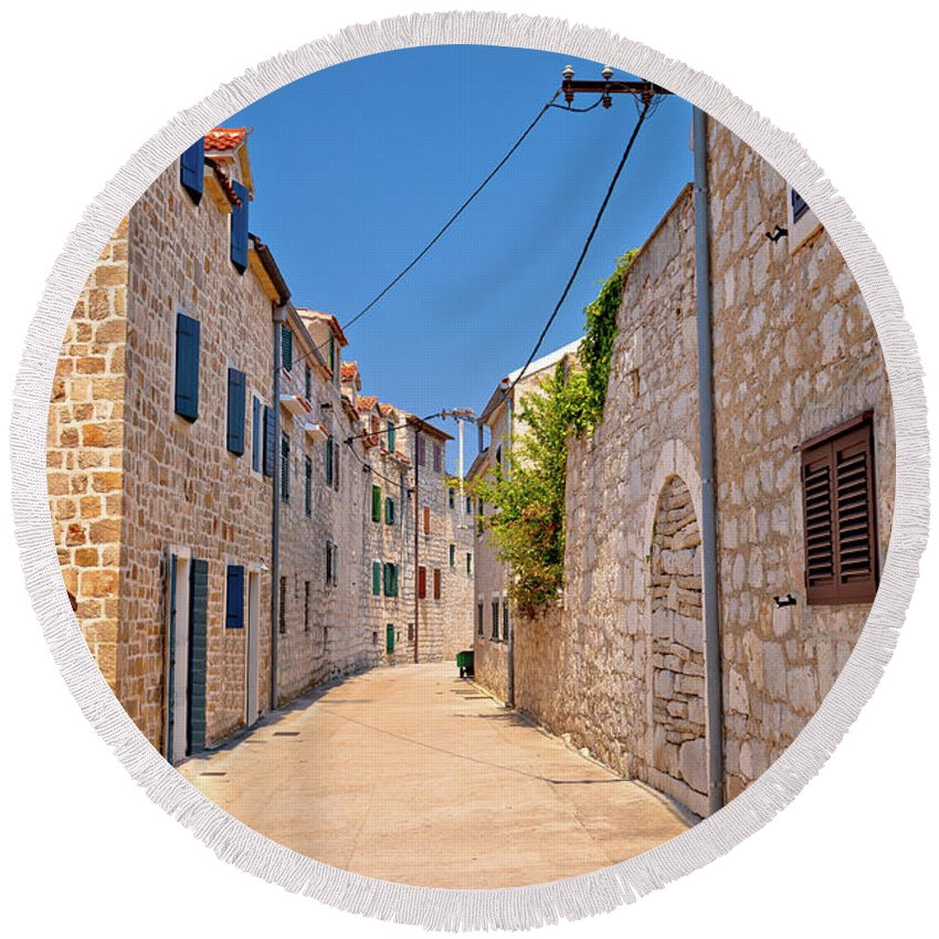 Prvic Round Beach Towel featuring the photograph Colorful Mediterranean Stone Street Of Prvic Island by Brch Photography