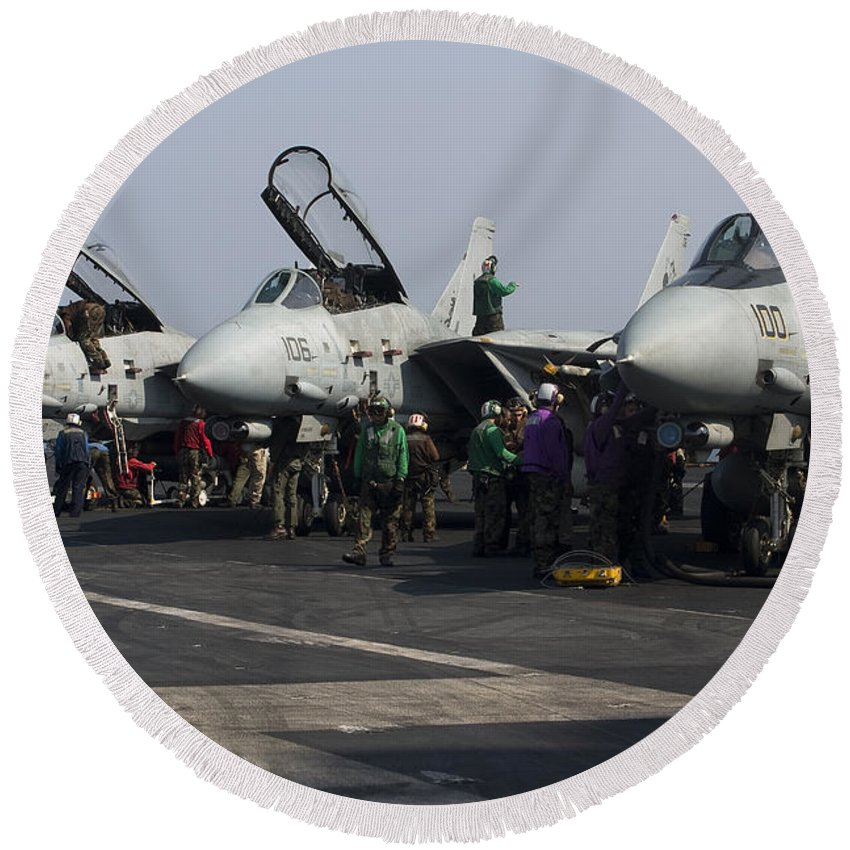 Grumman Round Beach Towel featuring the photograph F-14d Tomcats On The Flight Deck Of Uss by Gert Kromhout