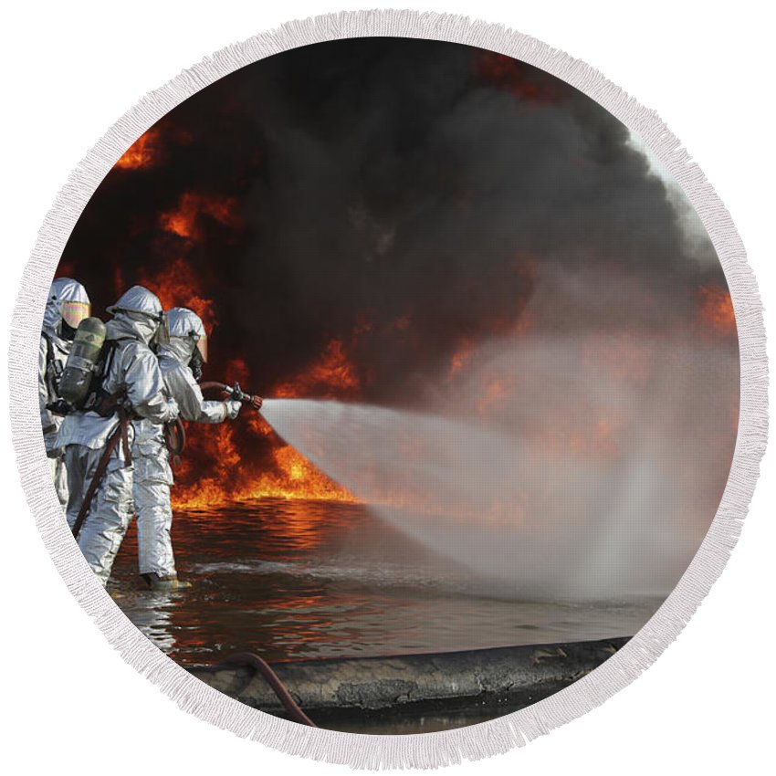 Military Round Beach Towel featuring the photograph Firefighting Marines Battle A Huge by Stocktrek Images