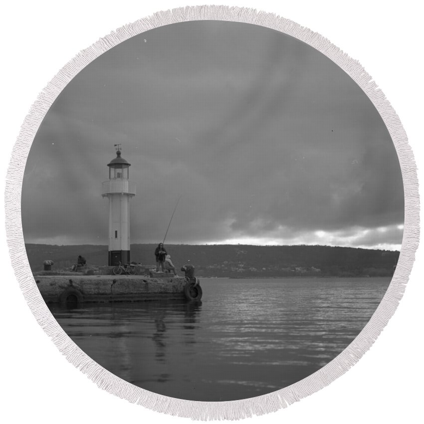 Fisherman Round Beach Towel featuring the photograph Fisherman by Evgeny Ivanov