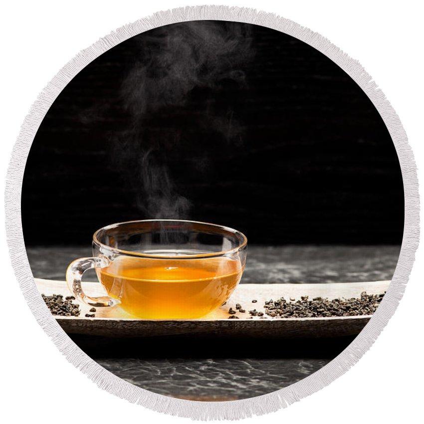 Green Round Beach Towel featuring the photograph Gunpowder Green Tea In Glass Teapot by Wolfgang Steiner