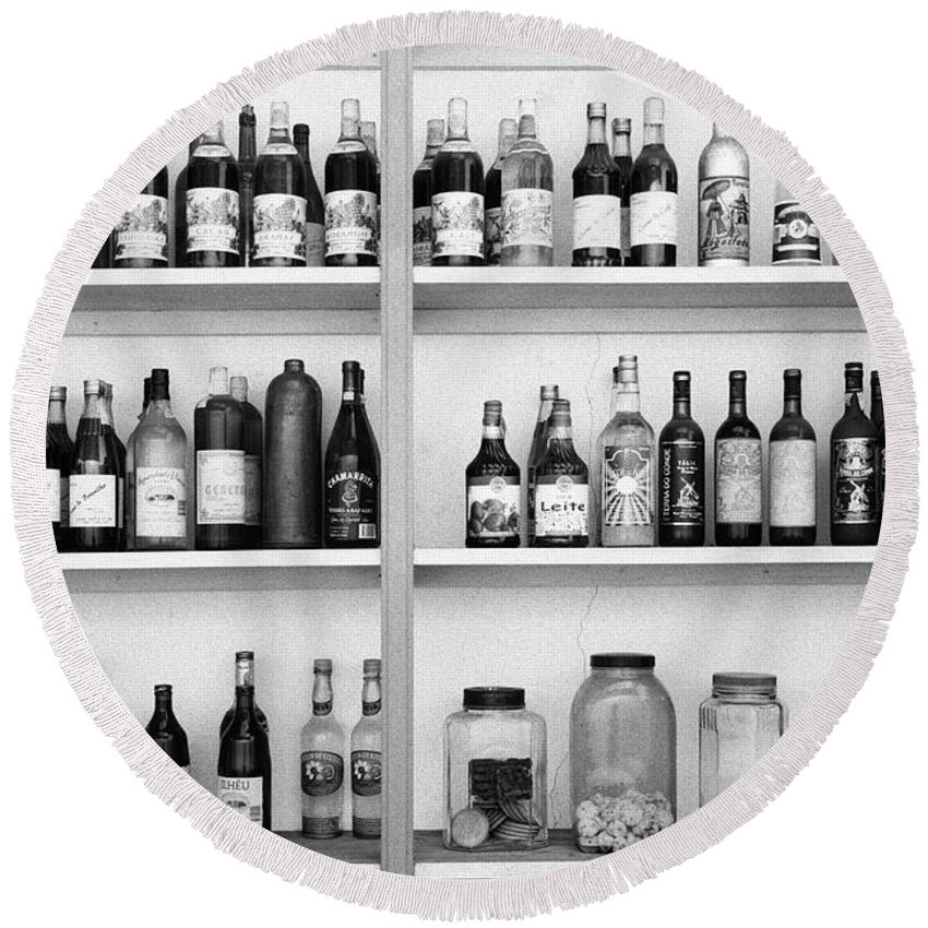Bottles Round Beach Towel featuring the photograph Liquor Bottles by Gaspar Avila